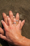 Intertwined hands Stock Photo