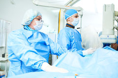 Interventional cardiology. Male surgeon doctor at operation. Interventional cardiology or radiology. Male surgeon doctor radiologist at operation during catheter Stock Photo