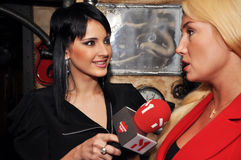 Interview. Ukrainian singer and leading music channel M1 Marta interviews with TV presenter Natalia Rozynska Royalty Free Stock Images