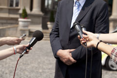 Interview. TV or radio reporters interview Royalty Free Stock Photo