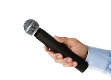 Interview. Male hand holding microphone for the interview Stock Photos