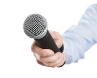 Interview. Male hand holding microphone for the interview isolated on white background Royalty Free Stock Photography