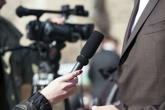 Interview. TV or radio reporter interview Stock Photos