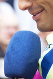 Interview. A microphone pointing towards viewer Stock Photo