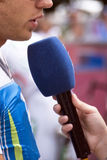 Interview. A microphone pointing towards viewer Royalty Free Stock Image