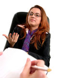 Interview. Woman giving an explanation Royalty Free Stock Image
