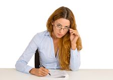 Interview businesswoman skeptically looking at you sitting at desk Royalty Free Stock Photography