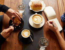 Interview in a cafe with coffee and pastry Stock Photo