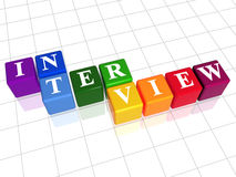Interview in colour. 3d colour boxes with text - interview, word Stock Photography