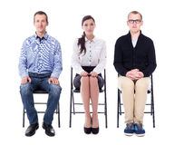 Interview concept - young people sitting on office chairs isolat Royalty Free Stock Images