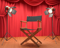Interview Film. Directors chair on the stage illuminated by floodlights Royalty Free Stock Photo