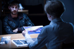 Interview in interrogation room Stock Photos