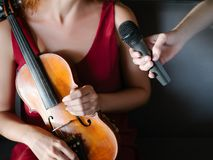 Interview journalist mass media communication. Broadcaster takes interview from a musician. story coverage. journalism media information communication concept Royalty Free Stock Photo
