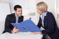 Interview with manager and young attractive man at office. Stock Image