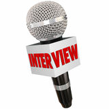 Interview Microphone Reporter Asking Questions Getting Answers. Interview word on a reporter's microphone to illustrate asking questions and getting answers and Royalty Free Stock Photography