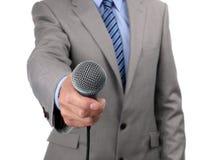 Interview mit Mikrofon stockbild