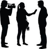 Interview mit Sternjournalisten und -kameramann Stockbild