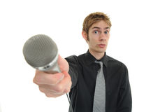 Interview News Reporter Journalist. News reporter journalist interviews a person holding up the microphone Stock Photos