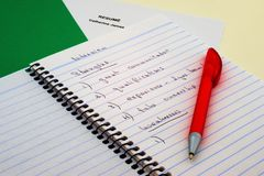 Interview Notes and Pen. Spiral notebook with list of strengths and weaknesses on top of folder with resume - in preparation for job interview royalty free stock photography