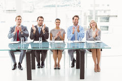 Interview panel clapping hands in office Stock Photos