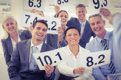Interview panel holding score cards Royalty Free Stock Photos