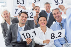 Interview panel holding score cards in office Royalty Free Stock Images