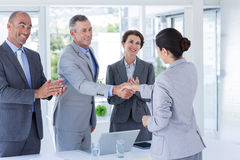 Interview panel shaking hands with applicant Stock Photos