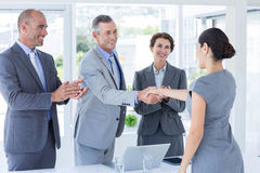 Interview panel shaking hands with applicant Stock Photography