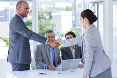 Interview panel shaking hands with applicant Royalty Free Stock Photography