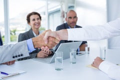 Interview panel shaking hands with applicant Royalty Free Stock Images