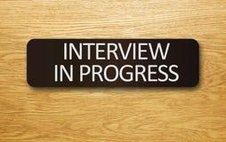 Interview in Progress. Sign on an office door Stock Photo