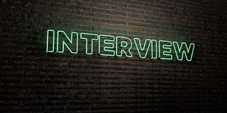 INTERVIEW -Realistic Neon Sign on Brick Wall background - 3D rendered royalty free stock image Royalty Free Stock Photos