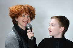 Interview. Son makes an interview with his attractive mother Royalty Free Stock Photos
