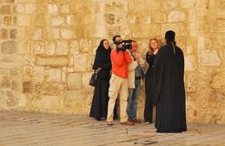 Interview on the square near the Holy Sepulchre in Jerusalem Royalty Free Stock Image