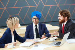 Interview for tv program. Arabian guest asking questions in tv studio Royalty Free Stock Image