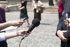 Interview. TV or radio reporters interview Royalty Free Stock Images