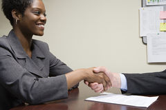 Interviewee and interviewer shaking hands Royalty Free Stock Photography