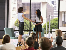 Interviewer greeting speaker on stage at a business seminar stock photos