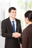 Interviewer shaking hand to future employee Stock Photo