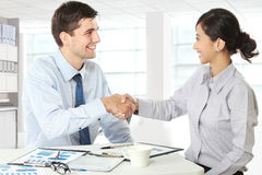 Interviewer shaking hand to future employee Stock Images