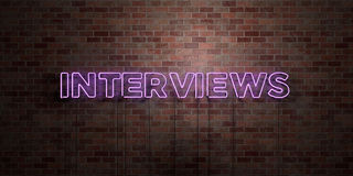INTERVIEWS - fluorescent Neon tube Sign on brickwork - Front view - 3D rendered royalty free stock picture Stock Images