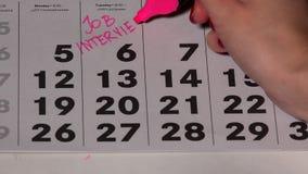 Intervju för kvinnaplanläggningsjobb på kalender Finger med markördanandeviktig lager videofilmer