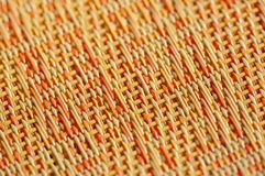 Warm colors of orange, red and yellow in an abstract woven background stock photo