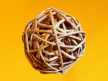 Interwoven wooden ball. An odd ball made of little interlaced branches Royalty Free Stock Images