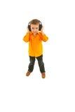 Intégral de la musique de écoute de gosse Images stock