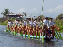 Intha leg rowing tribe in Myanmar. The famous leg-rowing Intha tribe on lake Inle in Myanmar (Burma) highlands, rowing their boat for the annual fiesta Royalty Free Stock Photography