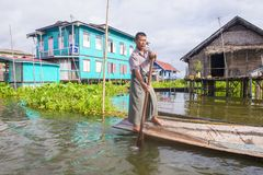 Intha man on his boat in Inle lake Myanmar Royalty Free Stock Photo