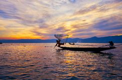 Tricks of fishermen on Inle Lake, Myanmar. INTHA, MYANMAR - FEBRUARY 18, 2018: The sunset on Inle Lake with a view on local fisherman, staying at the edge of Stock Photography