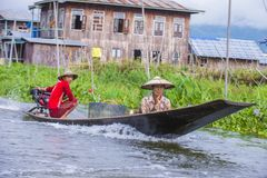 Intha woman on his boat in Inle lake Myanmar Stock Photos