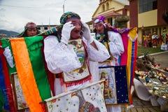 Inti Raymi celebation in Riobamba, Ecuador. RIOBAMBA, ECUADOR - JUNE 20, 2010: Unidentified dancers with elaborate colorful costume at Inti Raymi indigenous Royalty Free Stock Image